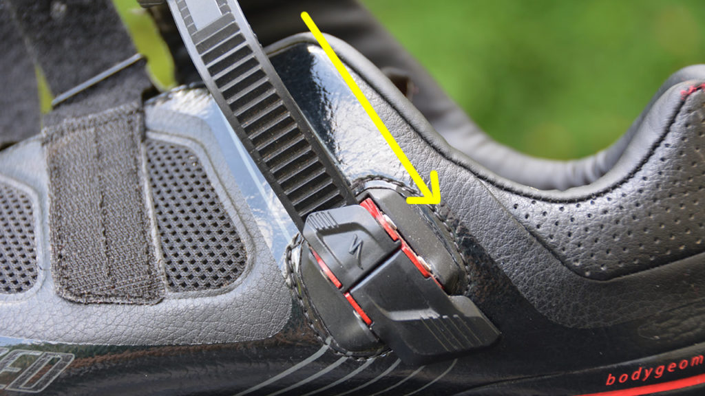 A traditional cycling shoe buckle