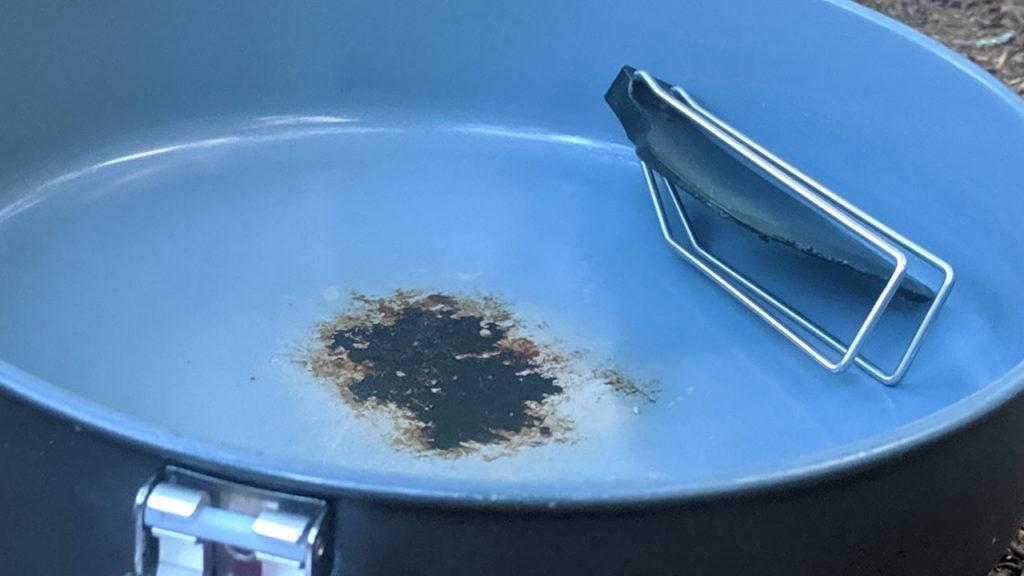 A patch of stuck on food in the MSR Windburner Ceramic Skillet