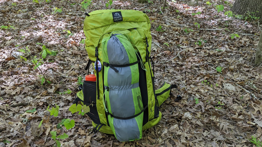 The gear straps on the Granite Gear Crown2 let you carry your tent outside the bag.